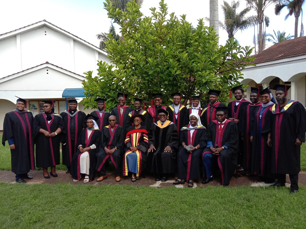 GRADUATES WITH THE FACULTY